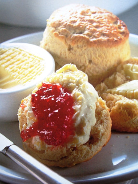 Traditional english tea time scones with jam and cream