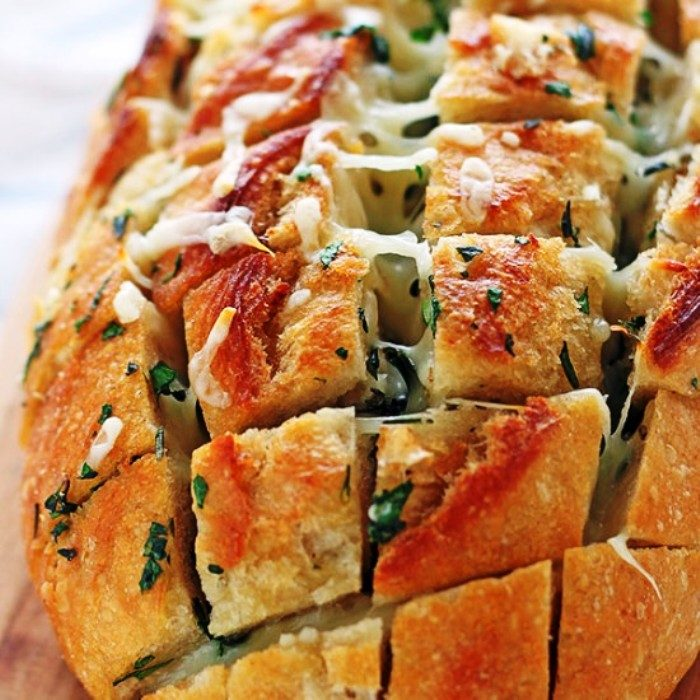 tasty filled bread recipe of Cheesy-garlic-herb-crack-bread