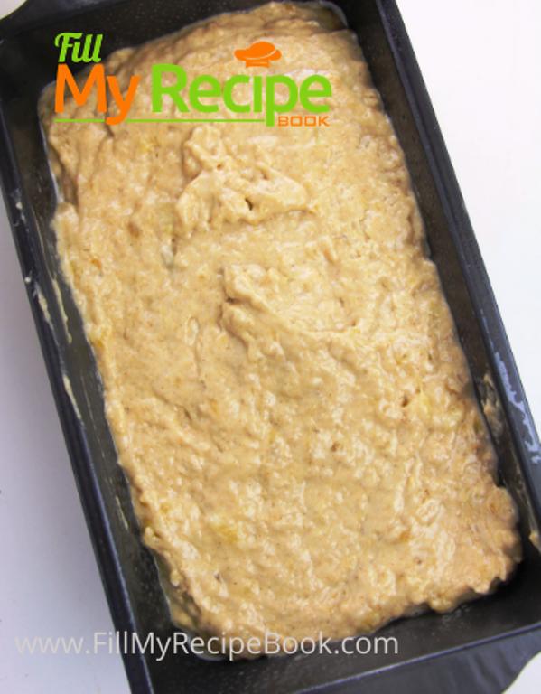 banana bread mixture placed in baking pan, filling banana bread