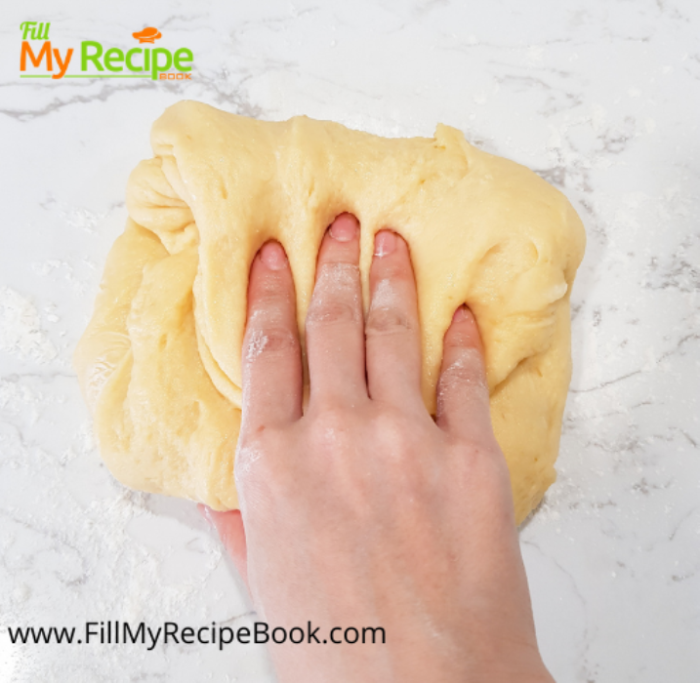 process of needing the dough of cream cheese kolache