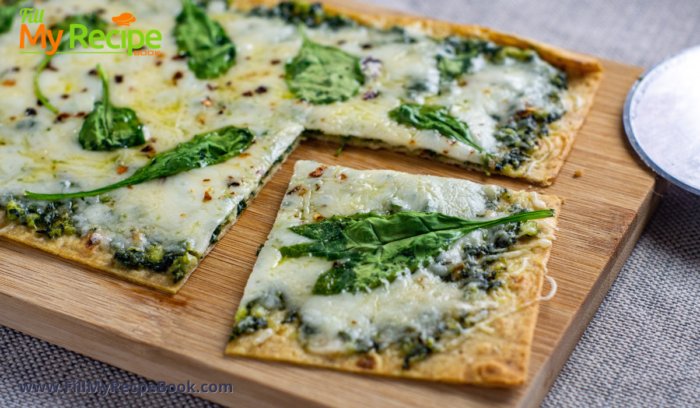 oven baked pesto flatbread cut for serving on a board