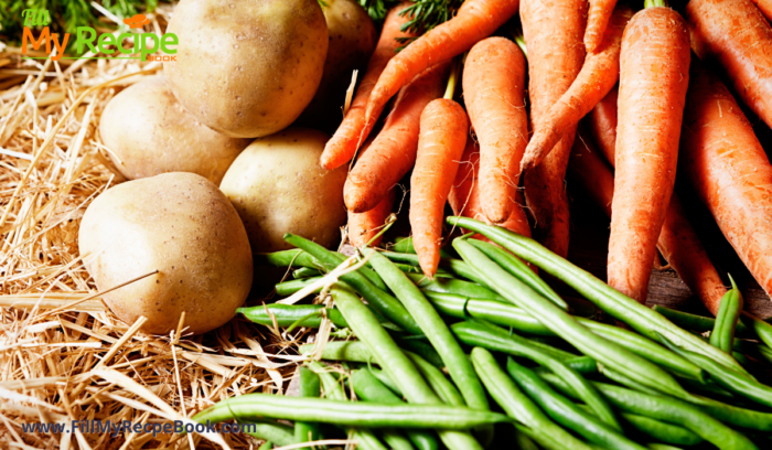 some fresh vegetables like carrots and green beans and potatoes.