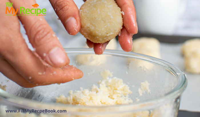 taking the coconut mixture making balls with your hands