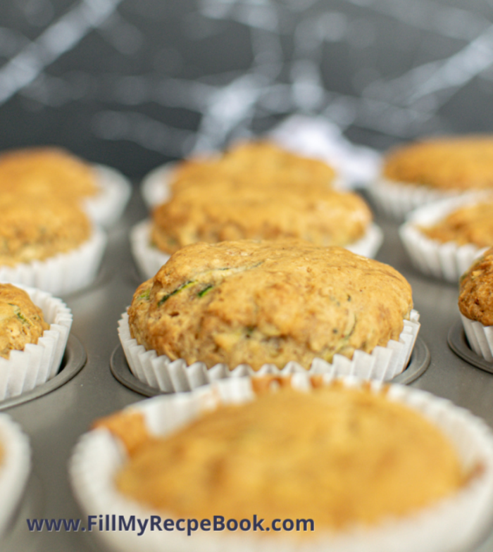 zucchini muffins in muffin pans cooling