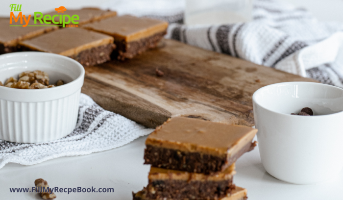 raw brownies with caramel on top served and slices on a board with nuts and chocolate chips