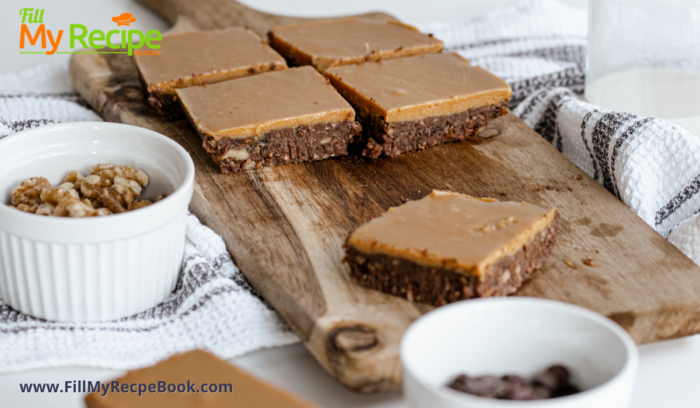 On a bread board some sliced cold brownies with caramel