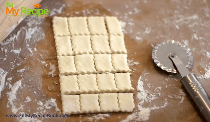 cutting dough into squares for Polish Kolaczki Cookies