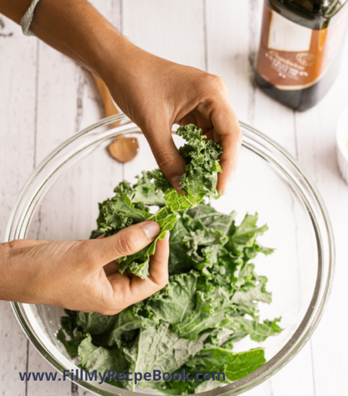 sorting freshly picked kale in a bowl to make chips