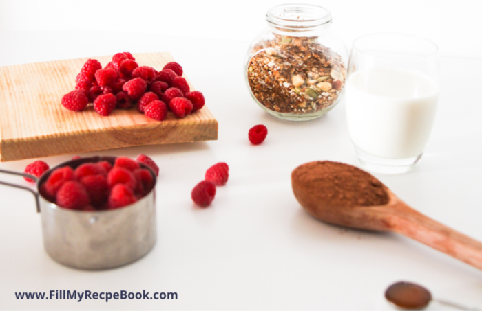 ingredients for a vegan berry and chocolate granola smoothie